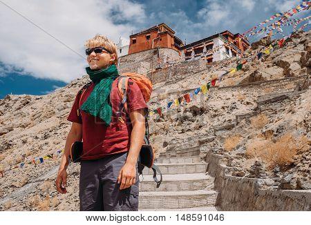 Young man tourist near the Tsemo Gompa Monastery in Leh