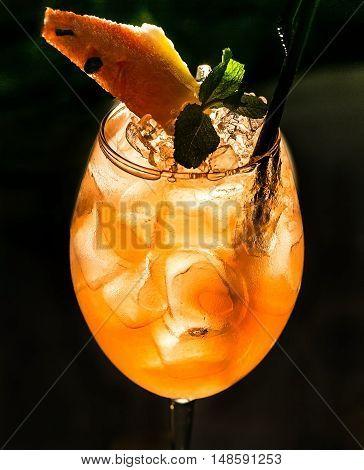 a Red watermelon cocktail on dark background