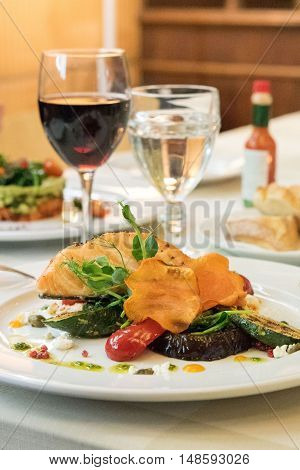 Salmon fish with glass of red wine