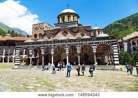 Rila, Bulgaria - June, 25, 2015: People near the church in Unesco World Heritage site famous Rila Monastery, Rilsky monastery or Monastery of Saint Ivan of Rila