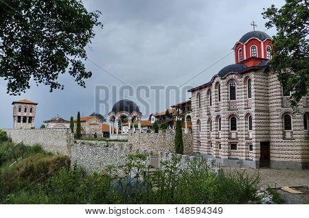 Giginski monastery, Bulgaria - June 25, 2016: General view of inner  yard  in restored Montenegrin or Giginski monastery  St. St. Cosmas and Damian, mountain  Kitka, Breznik, Pernik region, Bulgaria.  Visit in the place circa June 2016.