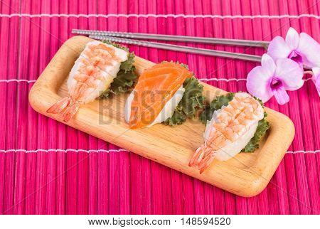 Japanese food sushi set , sushi with chopsticks on wooden background