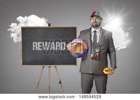 Reward text with holiday gear businessman and blackboard with text