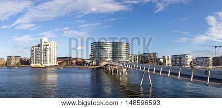 Copenhagen, Denmark - September 23, 2016: Modern cyclist bridge Bryggybroen and modern residential buildings