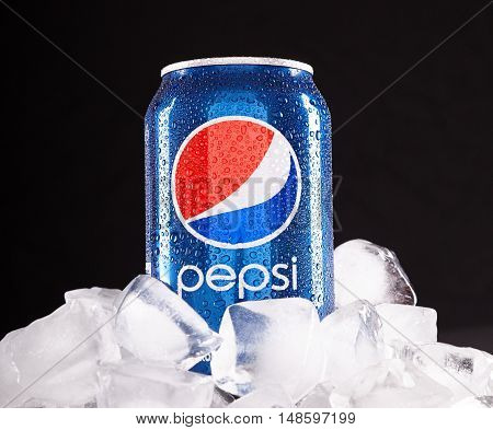 ODESSA UKRAINE - SEPTEMBER 12 2016: Can of Pepsi cola on ice. Pepsi is a carbonated soft drink that is produced and manufactured by PepsiCo. Created and developed in 1893.