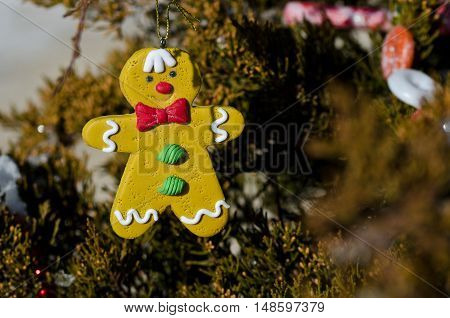 Gingerbread Man Decoration on an Outdoor Christmas Tree