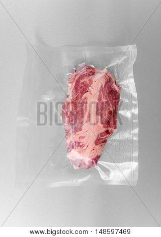 Vacuum sealed fresh Chuck eye steak for sous vide cooking