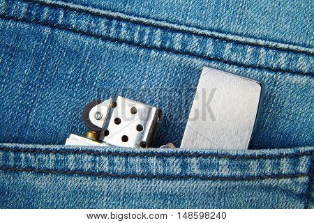 Lighter in the back pocket of jeans habit in your pocket every day jeans texture close-up