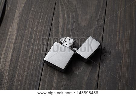 gasoline lighter metal lighter on the wooden background