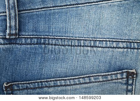 texture jeans of blue color the details of tailoring