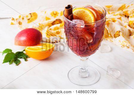mulled wine apple cinnamon orange chilled ice close-up grog sangria top