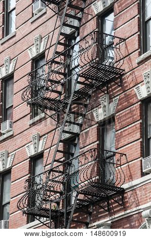 External fire escape staircase on old brick building
