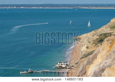 Alum Bay beach and pier on the western tip of the Isle of Wight.