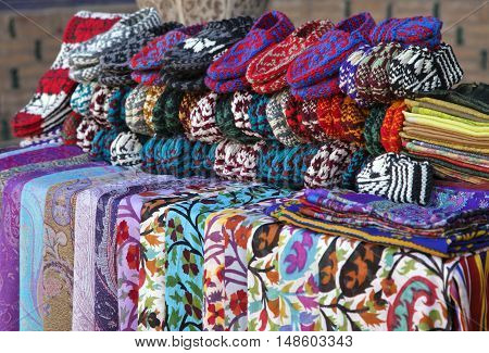 Street market with scarves and knitted slippers, Khiva, Uzbekistan