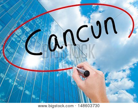 Man Hand Writing Cancun With Black Marker On Visual Screen