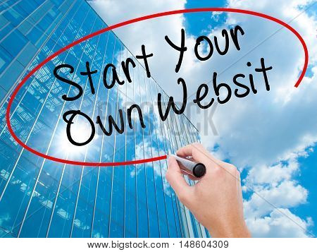 Man Hand Writing Start Your Own Website With Black Marker On Visual Screen