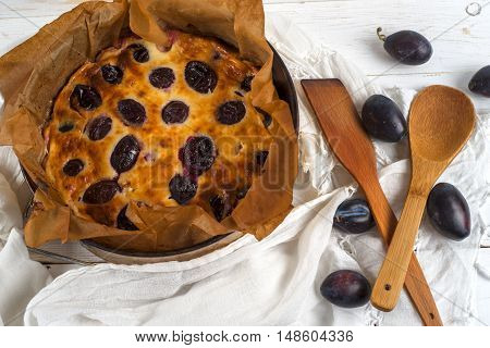 plum cake on a brown table. Cook at home