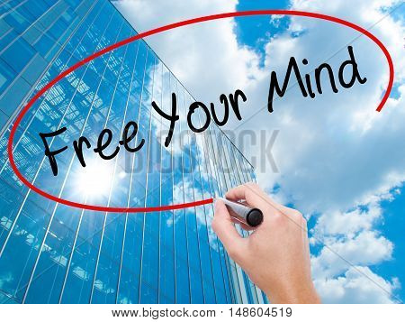 Man Hand Writing Free Your Mind With Black Marker On Visual Screen
