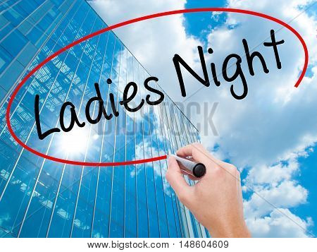 Man Hand Writing Ladies Night With Black Marker On Visual Screen