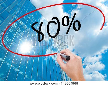 Man Hand Writing 80% With Black Marker On Visual Screen