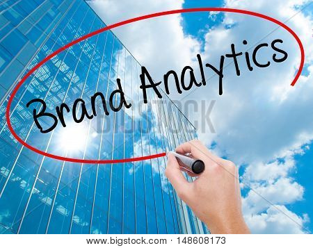 Man Hand Writing Brand Analytics With Black Marker On Visual Screen