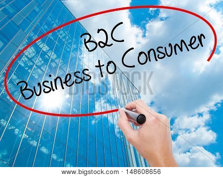 Man Hand Writing B2C Business To Consumer With Black Marker On Visual Screen
