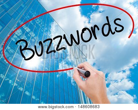 Man Hand Writing Buzzwords With Black Marker On Visual Screen