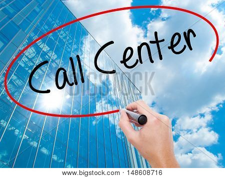 Man Hand Writing Call Center With Black Marker On Visual Screen.