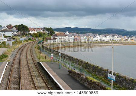 DEGANWY, UK - SEPTEMBER 21, 2016: Deganwy railway station and estuary, photograph taken from railway station bridge, Deganwy, Wales, UK