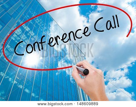 Man Hand Writing Conference Call With Black Marker On Visual Screen.