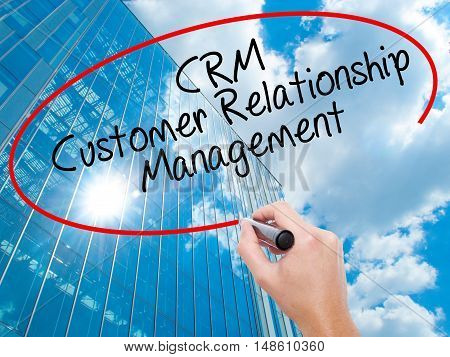 Man Hand Writing Crm Customer Relationship Management  With Black Marker On Visual Screen