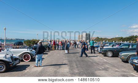 Bystanders Watching Old Cars