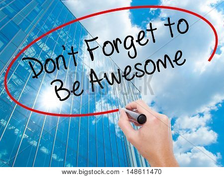 Man Hand Writing Don't Forget To Be Awesome With Black Marker On Visual Screen