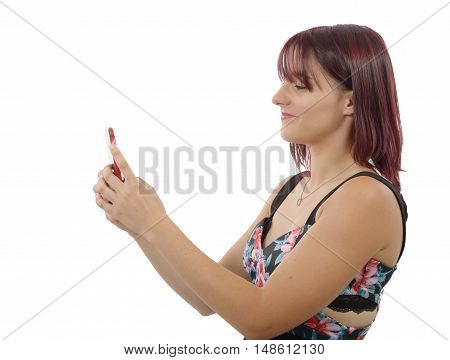 a pretty young woman sending a text message