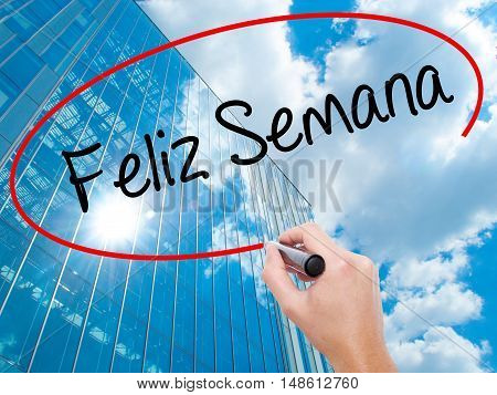 Man Hand Writing Feliz Semana  (happy Week In Spanish/portuguese) With Black Marker On Visual Screen