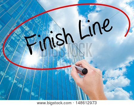Man Hand Writing Finish Line With Black Marker On Visual Screen