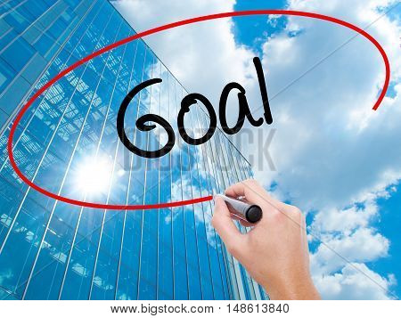 Man Hand Writing Goal  With Black Marker On Visual Screen