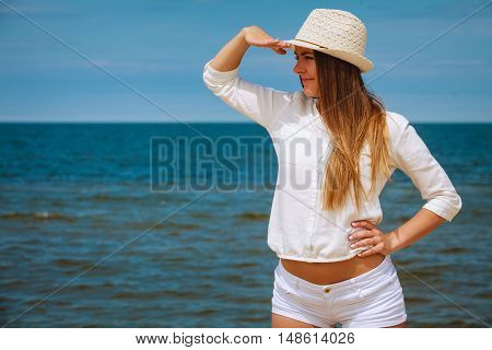 Female Tourist Resting On Beach.