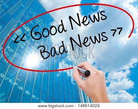 Man Hand Writing Good News - Bad News With Black Marker On Visual Screen.