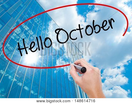 Man Hand Writing  Hello October  With Black Marker On Visual Screen