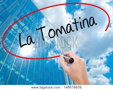 Man Hand Writing La Tomatina With Black Marker On Visual Screen