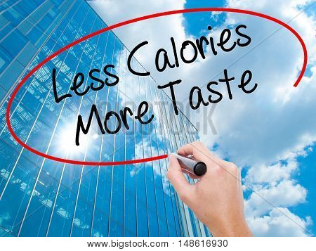 Man Hand Writing Less Calories More Taste With Black Marker On Visual Screen
