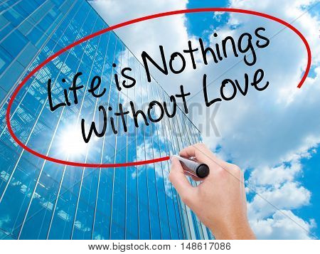 Man Hand Writing Life Is Nothings Without Love With Black Marker On Visual Screen