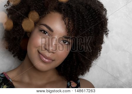 Close-up portrait of a beautiful young African American woman looking at camera
