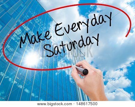 Man Hand Writing Make Everyday Saturday With Black Marker On Visual Screen.