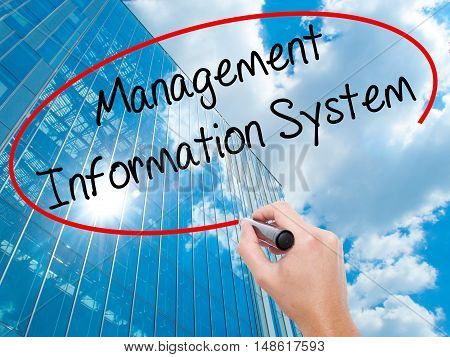 Man Hand Writing Management Information System With Black Marker On Visual Screen.