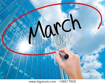 Man Hand Writing March With Black Marker On Visual Screen