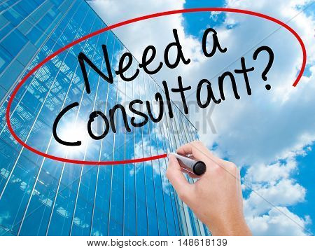 Man Hand Writing Need A Consultant? With Black Marker On Visual Screen