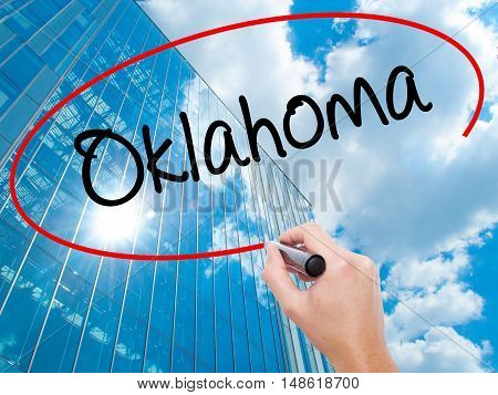 Man Hand Writing Oklahoma With Black Marker On Visual Screen