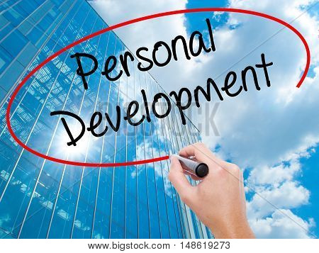 Man Hand Writing Personal Development  With Black Marker On Visual Screen.